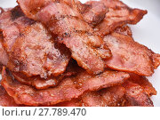 Купить «Crispy fried bacon slices cooked on bbq grill», фото № 27789470, снято 17 июля 2019 г. (c) PantherMedia / Фотобанк Лори