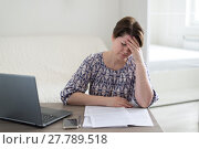Купить «Tired of work woman holding her head», фото № 27789518, снято 21 января 2018 г. (c) Володина Ольга / Фотобанк Лори