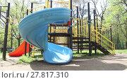 Купить «Adorable little girl has fun riding on a slide at playground in the park at the day time», видеоролик № 27817310, снято 10 мая 2016 г. (c) Алексей Кузнецов / Фотобанк Лори