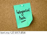 Купить «Integrated Data written on green paper note», фото № 27817854, снято 16 января 2019 г. (c) PantherMedia / Фотобанк Лори