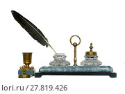19th century inkstand with a stone base, brass parts and a bird feather sticking from the cut-glass inkwell, isolated. Стоковое фото, фотограф Евгений Харитонов / Фотобанк Лори