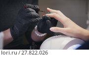 Купить «Close up view of polishing nails - female get professional manicure in beauty shop», фото № 27822026, снято 19 февраля 2019 г. (c) Константин Шишкин / Фотобанк Лори
