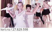 Купить «Group of children dancing tango in dance studio», фото № 27829598, снято 13 июля 2017 г. (c) Яков Филимонов / Фотобанк Лори
