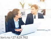 Купить «cheerful young man and charming woman coworkers talking in firm», фото № 27829762, снято 31 мая 2020 г. (c) Яков Филимонов / Фотобанк Лори