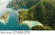 Купить «Coron, Palawan, Philippines, aerial view of beautiful Twin lagoon and limestone cliffs. Fisheye view.», видеоролик № 27830270, снято 5 февраля 2018 г. (c) Mikhail Davidovich / Фотобанк Лори
