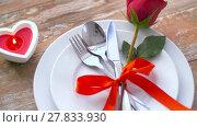 Купить «close up of red rose flower on set of dishes», видеоролик № 27833930, снято 10 февраля 2018 г. (c) Syda Productions / Фотобанк Лори