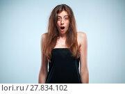 Купить «Portrait of young woman with shocked facial expression», фото № 27834102, снято 21 апреля 2019 г. (c) PantherMedia / Фотобанк Лори