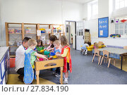 Купить «Group of Children Playing in a Classroom», фото № 27834190, снято 24 июля 2019 г. (c) PantherMedia / Фотобанк Лори