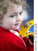 Купить «Girl Playing Tambourine at Nursery», фото № 27834226, снято 25 марта 2019 г. (c) PantherMedia / Фотобанк Лори