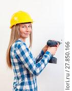 Купить «Young woman doing the DIY work and wearing protective helmet», фото № 27850166, снято 24 августа 2019 г. (c) easy Fotostock / Фотобанк Лори