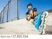 Купить «Roller boy resting on the steps of skate park», фото № 27855554, снято 14 октября 2017 г. (c) Сергей Новиков / Фотобанк Лори