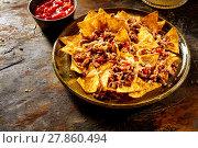 Купить «Nacho chips, cheese and beef with copy space», фото № 27860494, снято 20 марта 2019 г. (c) PantherMedia / Фотобанк Лори