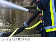 Купить «firemen sprayed extinguishing water during an exercise.», фото № 27870490, снято 13 ноября 2018 г. (c) PantherMedia / Фотобанк Лори