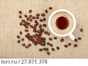 Купить «Empty espresso cup and coffee beans on canvas», фото № 27871378, снято 20 октября 2018 г. (c) PantherMedia / Фотобанк Лори