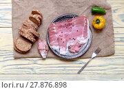 Купить «Pieces of Italian prosciutto on a plate», фото № 27876898, снято 15 февраля 2018 г. (c) Татьяна Ляпи / Фотобанк Лори