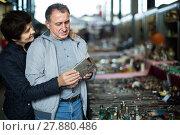 Купить «calm mature spouses buying retro handicrafts on flea market», фото № 27880486, снято 23 октября 2017 г. (c) Яков Филимонов / Фотобанк Лори