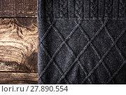 Купить «Grey figured sweater on the wooden background», фото № 27890554, снято 20 марта 2019 г. (c) PantherMedia / Фотобанк Лори