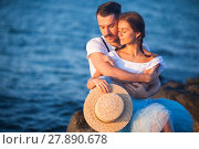 Купить «Happy young romantic couple relaxing on the beach watching the sunset», фото № 27890678, снято 20 июня 2019 г. (c) PantherMedia / Фотобанк Лори