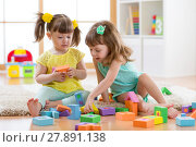Купить «Kids are playing with montessori toys», фото № 27891138, снято 19 сентября 2018 г. (c) Оксана Кузьмина / Фотобанк Лори