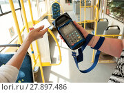 Купить «Human hand holding plastic cards. Passenger pays for fare in public transport. Payment terminal, credit card reader, sales concept.», фото № 27897486, снято 18 июля 2019 г. (c) PantherMedia / Фотобанк Лори