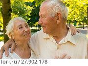 Купить «The happy old couple in the summer on a walk», фото № 27902178, снято 20 июня 2019 г. (c) PantherMedia / Фотобанк Лори