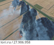 Купить «Burning straw in the fields», фото № 27906958, снято 20 февраля 2020 г. (c) PantherMedia / Фотобанк Лори
