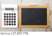 Купить «chalkboard and calculator», фото № 27907778, снято 19 февраля 2020 г. (c) PantherMedia / Фотобанк Лори