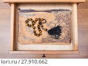 Купить «rosary on ansient book in open drawer», фото № 27910662, снято 21 марта 2018 г. (c) PantherMedia / Фотобанк Лори