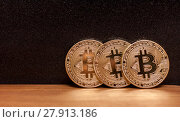 Three golden bitcoin coins. Стоковое фото, фотограф Anton Chechotkin / Фотобанк Лори