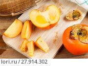 Купить «Persimmon yellow color fruits», фото № 27914302, снято 24 мая 2018 г. (c) PantherMedia / Фотобанк Лори