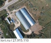 Купить «Hangar of galvanized metal sheets for storage of agricultural products», фото № 27915110, снято 18 января 2019 г. (c) PantherMedia / Фотобанк Лори