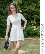 Купить «summery portrait of a young woman with shoes», фото № 27915654, снято 27 мая 2019 г. (c) PantherMedia / Фотобанк Лори