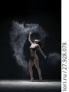 Купить «Woman jumping gracefully in dust cloud view», фото № 27928078, снято 21 января 2018 г. (c) Гурьянов Андрей / Фотобанк Лори