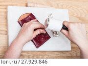Купить «craftsman corrects embossing of leather pouch», фото № 27929846, снято 23 февраля 2019 г. (c) PantherMedia / Фотобанк Лори