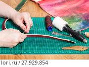 Купить «craftsman stitches leather belt for embossed bag», фото № 27929854, снято 22 марта 2019 г. (c) PantherMedia / Фотобанк Лори