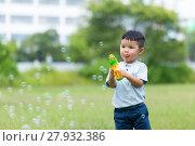 Купить «Asian boy play with the bubble blower», фото № 27932386, снято 23 февраля 2019 г. (c) PantherMedia / Фотобанк Лори