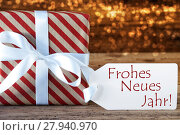 Купить «Atmospheric Christmas Gift With Label, Neues Jahr Means New Year», фото № 27940970, снято 27 мая 2019 г. (c) PantherMedia / Фотобанк Лори
