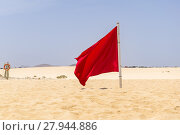 Купить «Red flag flying in the wind on the beach», фото № 27944886, снято 20 сентября 2018 г. (c) PantherMedia / Фотобанк Лори