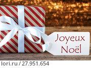 Купить «Atmospheric Gift With Label, Joyeux Noel Means Merry Christmas», фото № 27951654, снято 26 мая 2019 г. (c) PantherMedia / Фотобанк Лори