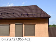 Купить «The roof of corrugated sheet on a building», фото № 27955462, снято 26 мая 2019 г. (c) PantherMedia / Фотобанк Лори