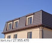 Купить «The house with plastic windows and a roof of corrugated sheet», фото № 27955470, снято 26 мая 2019 г. (c) PantherMedia / Фотобанк Лори