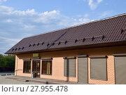 Купить «The roof of corrugated sheet on a building», фото № 27955478, снято 26 мая 2019 г. (c) PantherMedia / Фотобанк Лори