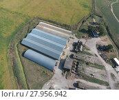 Купить «Hangar of galvanized metal sheets for storage of agricultural products», фото № 27956942, снято 19 августа 2018 г. (c) PantherMedia / Фотобанк Лори