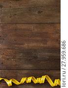Купить «A coiled yellow measuring tape», фото № 27959686, снято 20 февраля 2018 г. (c) PantherMedia / Фотобанк Лори