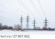 Купить «Electricity pylons and power lines in the winter day», фото № 27967062, снято 20 марта 2019 г. (c) PantherMedia / Фотобанк Лори