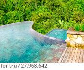Купить «Bali, Indonesia - April 13, 2014: View of swimming pool at Ubud Hanging Gardens hotel», фото № 27968642, снято 20 февраля 2019 г. (c) PantherMedia / Фотобанк Лори