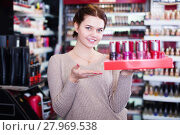 Купить «Seller demonstrating assortment», фото № 27969538, снято 21 февраля 2017 г. (c) Яков Филимонов / Фотобанк Лори