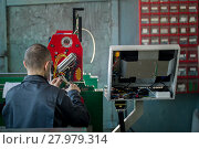 Купить «Electrician with scissor is installing energy system on machinery industry», фото № 27979314, снято 12 февраля 2018 г. (c) Константин Шишкин / Фотобанк Лори