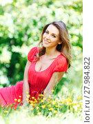 Купить «young woman in red dress sitting on grass», фото № 27984822, снято 10 июня 2015 г. (c) Иван Михайлов / Фотобанк Лори