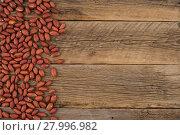 Купить «Peeled peanuts on an old wooden table.», фото № 27996982, снято 21 сентября 2019 г. (c) PantherMedia / Фотобанк Лори